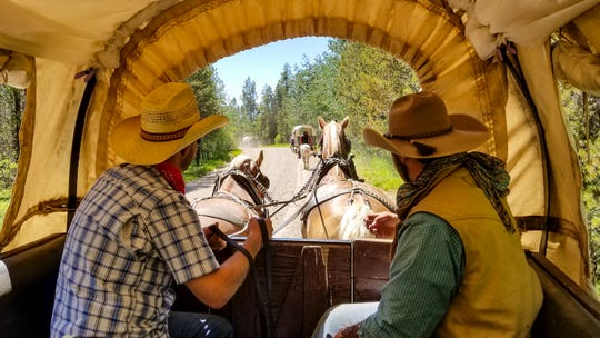 Teton Wagon Train & Horse Adventure lets glampers take their adventure on the road with a covered wagon journey from camp to camp.