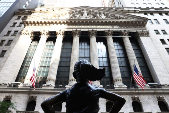 "The ""Fearless Girl"" statue in front of the New York Stock Exchange (NYSE) at Wall Street on July 23, 2020 in New York City."