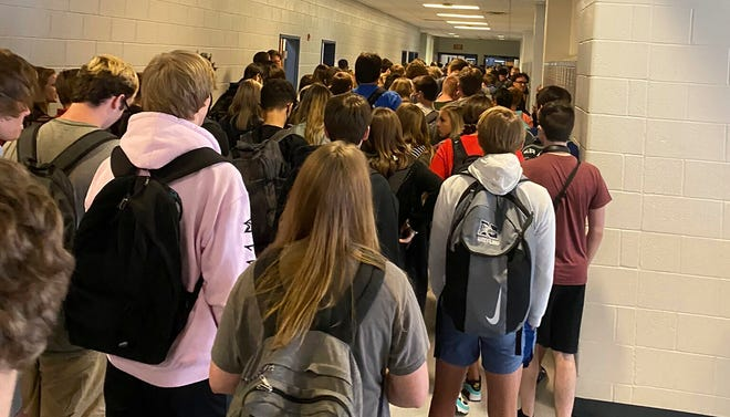 In this photo posted on Twitter, students crowd a hallway, Tuesday, Aug. 4, 2020, at North Paulding High School in Dallas, Ga.  The Georgia high school student says she has been suspended for five days because of photos of crowded conditions that she provided to The Associated Press and other news organizations. Hannah Waters, a 15-year-old sophomore at North Paulding High School, says she and her family view the suspension as overly harsh and are appealing it. (Twitter via AP, File)