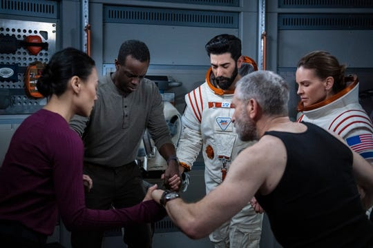"""International space crew Yu (Vivian Wu, left), Kwesi (Ato Essandoh), Ram (Ray Panthaki), Misha (Mark Ivanir) and Emma (Hilary Swank) must learn to live and work together in close quarters in """"Away."""""""