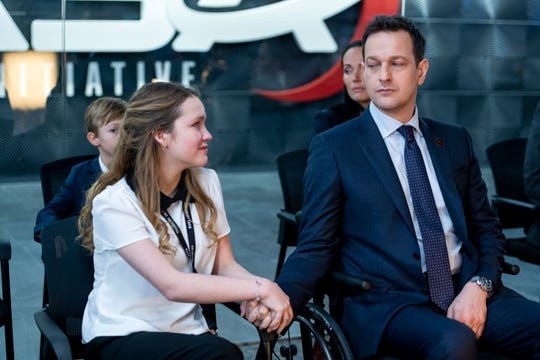 Alexis (Talitha Bateman, left) helps care for her dad, Matt (Josh Charles), while Emma is in space.