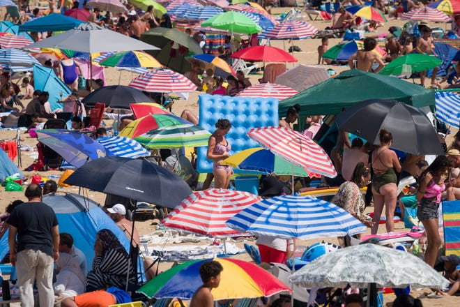 Crowds build up on Margate beach outside of London amid a three-day heatwave in the U.K. and France.