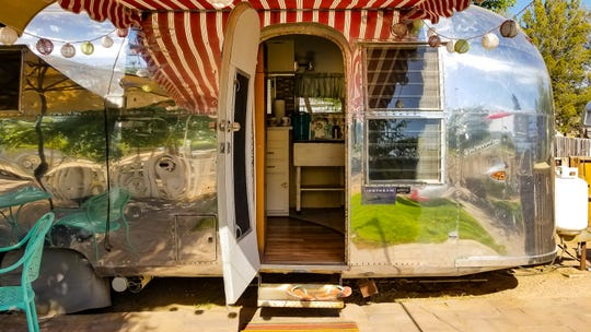 Guests at Cozy Peach sleep in restored vintage Airstream trailers.