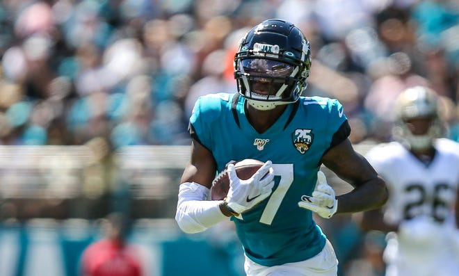 Jaguars wide receiver D.J. Chark runs with a catch in a 2019 game against the Saints. Chark is expected to assume a leading role this year in the Jacksonville offense. [Gary Lloyd McCullough/For The Florida Times-Union]
