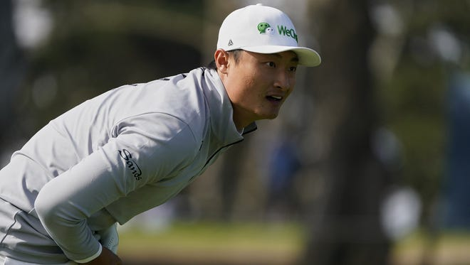 Haotong Li of China watches his tee shot on the ninth hole during the second round of the PGA Championship golf tournament at TPC Harding Park on Friday in San Francisco.