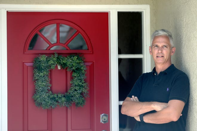 Bob Garick stands by the entrance to his home Wednesday in Oviedo. Garick was looking forward to being a field supervisor during the door-knocking phase of the 2020 census, but as the number of new coronavirus cases in Florida shot up last month, he changed his mind and decided not to take the job. [John Raoux/The Associated Press]