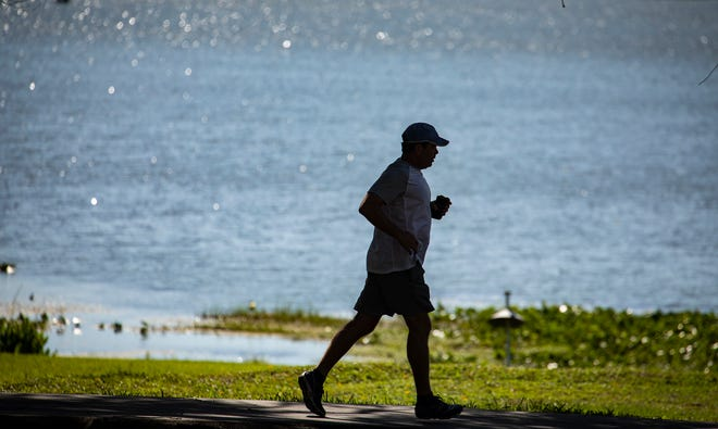 Lakeland residents are using the early morning and evening hours to get their exercise in at Lake Hollingsworth during the current hot summer temperatures of 2020. [ERNST PETERS/THE LEDGER]