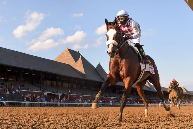 Tiz the Law crosses the finish line to win the Travers Stakes horse race at Saratoga, Saturday, Aug. 8, 2020, in Saratoga Springs, N.Y.