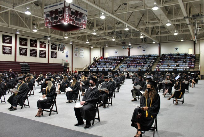 Graduates were seated apart, with McMurry University faculty placed in permanent seating in Kimbrell Arena for Saturday's ceremony. Parents and friends watched via livestream presentation. Aug 3 2020