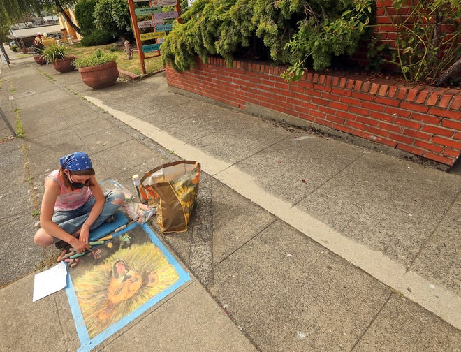 Madelyn Alford, 14, of Poulsbo, creates her chalk art piece on the Fifth Street sidewalk during the Bremerton First Friday Art Walk chalk art competition in downtown Bremerton on Friday.