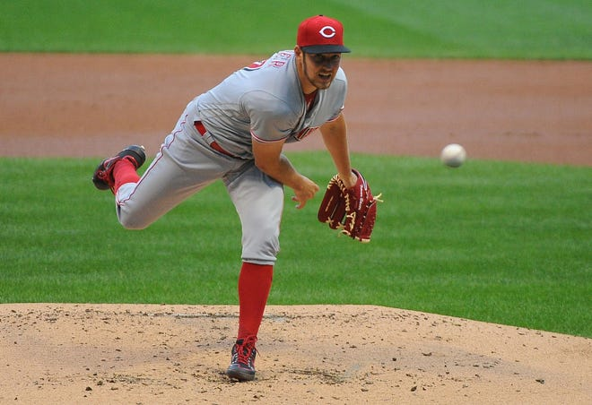 Aug 7, 2020; Milwaukee, Wisconsin, USA;  Cincinnati Reds starting pitcher Trevor Bauer (27) delivers a pitch against the Milwaukee Brewers in the first inning at Miller Park. Mandatory Credit: Michael McLoone-USA TODAY Sports