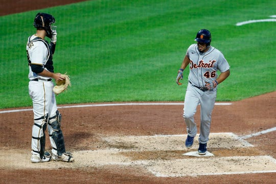 The Detroit Tigers' 46-year-old James Candelario crosses the home board with a run in front of Pittsburgh's pirate catch of Jacob Stollings after a moan of relief Stephen Braul walks Jacoby Jones with the bases loaded in the fifth inning of a baseball game on August 7, 2020. Pittsburgh.  (AP Photo / Keith Srakocic)