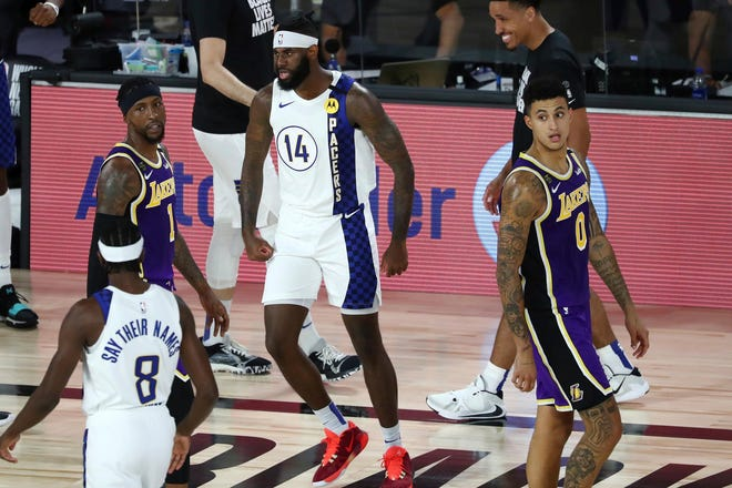 Indiana Pacers forward JaKarr Sampson (14) reacts after a play during the first quarter of an NBA basketball game against the Los Angeles Lakers, Saturday, Aug. 8, 2020, in Lake Buena Vista, Fla.