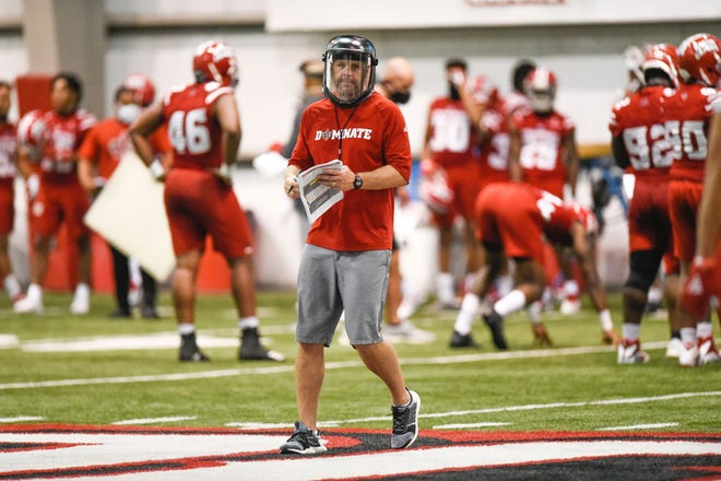 UL coach Billy Napier was wearing a face shield to guard against the coronavirus (COVID-19) when preseason camp opened Friday.