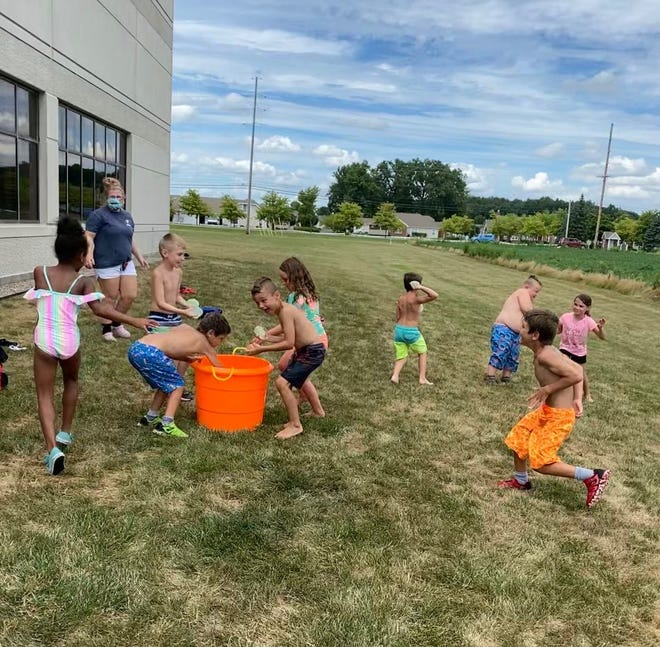Children play at the Marion Family YMCA day camp.