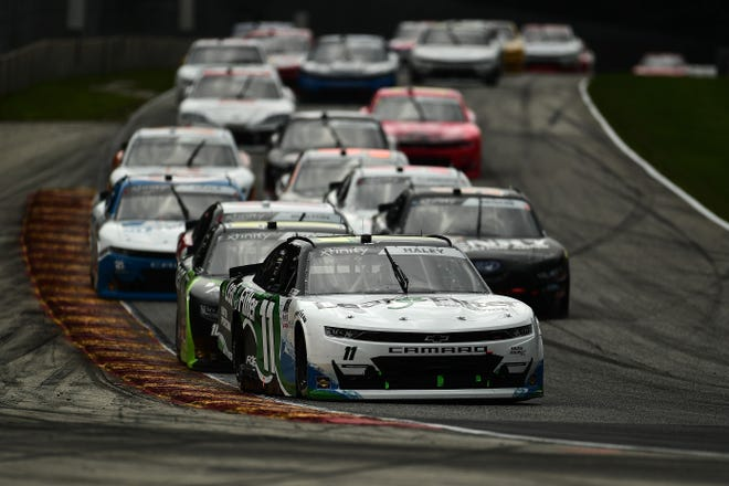 Justin Haley leads a pack of cars into Turn 5 during the 2020 Henry 180 NASCAR Xfinity Series race at Road America.