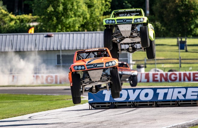 Robby Gordon leads his 12-year-old son, Max, and another Stadium Super Trucks racer over a jump Thursday, August 6, 2020, at Road America in Elkhart Lake, Wisconsin.