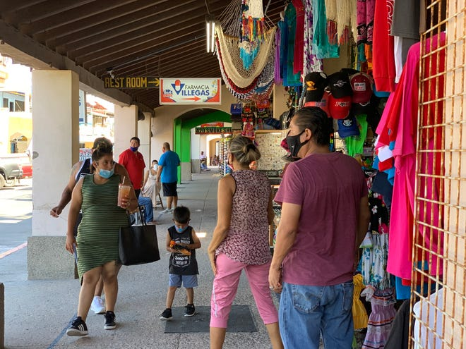 Several tourists walk through the Malecón in Puerto Peñasco on Aug. 6, 2020. The city has reopened its beaches after five months due to COVID-19.