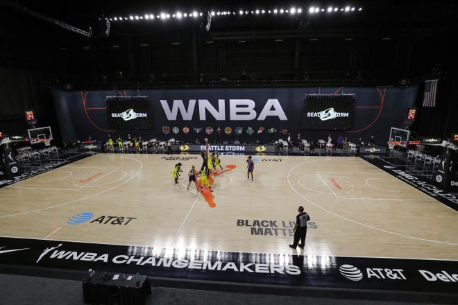 A general view of tipoff between Phoenix Mercury and Seattle Storm during the first half of a WNBA basketball game Saturday, Aug. 8, 2020, in Bradenton, Fla. (AP Photo/Mike Carlson)