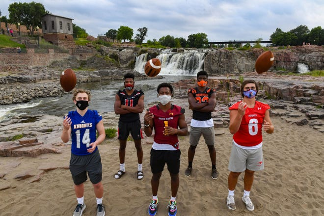 High school football players Conor Pavelko of O'Gorman, Jackson Hilton of Brandon Valley, Tyler Feldkamp of Roosevelt, Randolph Kpai of Washington and Tommy Thompson of Lincoln stand for a portrait on Friday, August 7, at Falls Park in Sioux Falls.