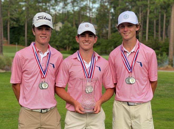 From left to right: Chiles High School golfers Jake Springer, Trey Buehler and Patrick McCann show off the second-place medals and trophy from the High School Golf National Invitational.