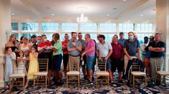 Country club members, few wearing facemasks, await the US president's arrival ahead of a news conference in Bedminster, New Jersey, on August 7, 2020. (Photo by JIM WATSON / AFP) (Photo by JIM WATSON/AFP via Getty Images) ORIG FILE ID: AFP_1WD2NW