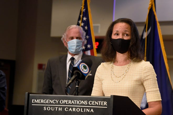 South Carolina Gov. Henry McMaster, left, looks on as state epidemiologist Linda Bell speaks during a COVID-19 briefing July 29.