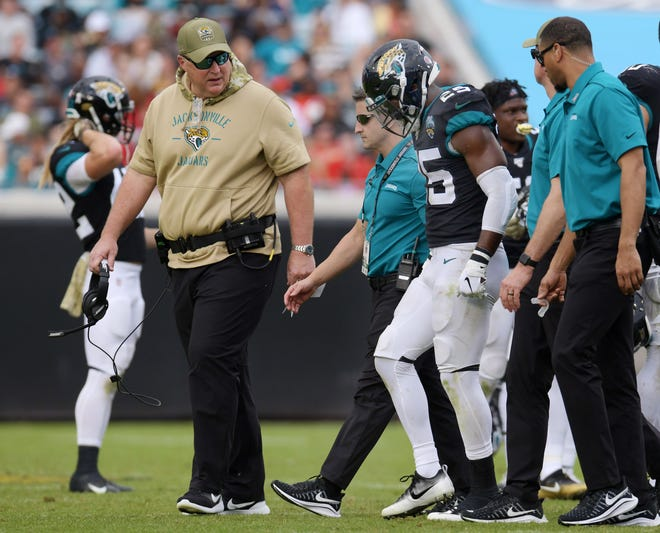 Jaguars coach Doug Marrone (left) and trainers walk with D.J. Hayden after he sustained an injury last season against Tampa Bay.