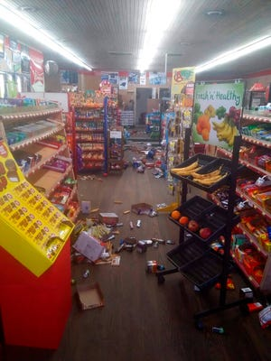 Various items litter the floor of the 4 Brothers Store in Sparta, N.C. after an earthquake shook much of North Carolina early Sunday, Aug. 9, 2020. (Michael Hull via AP)