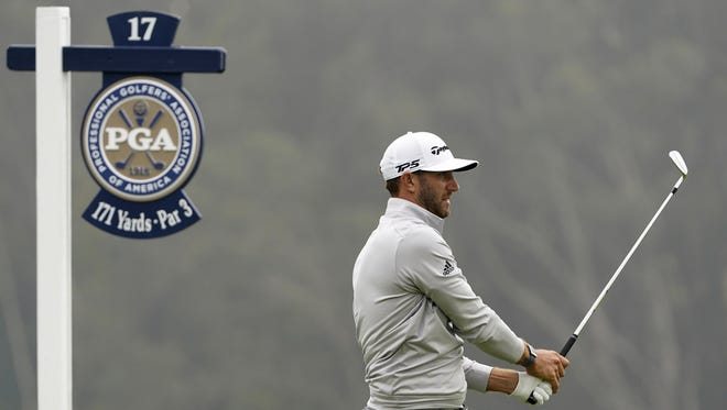 Dustin Johnson watches his tee shot on the 17th hole during the third round of the PGA Championship on Saturday at TPC Harding Park in San Francisco.