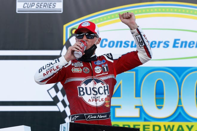 Kevin Harvick celebrates after winning a NASCAR Cup Series auto race at Michigan International Speedway in Brooklyn, Mich., on Sunday. [Paul Sancya/The Associated Press]