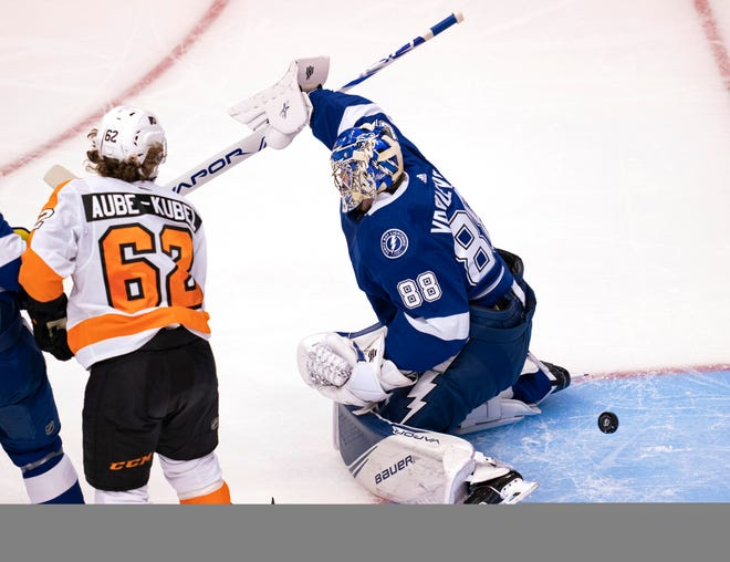 Philadelphia Flyers right wing Nicolas Aube-Kubel (62) scores on Tampa Bay Lightning goaltender Andrei Vasilevskiy (88) during the first period of a playoff game Saturday in Toronto. [Frank Gunn, The Canadian Press]
