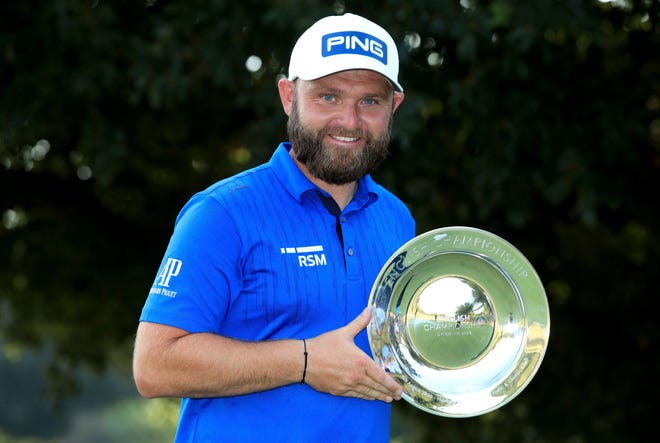 England's Andy Sullivan celebrates winning the English Championship on day four of the English Championship at Hanbury Manor Marriott Hotel and Country Club, Ware, England, on Sunday. [Adam Davy, The Associated Press]