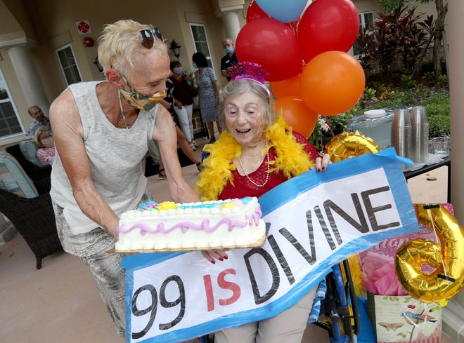 """Isabel """"Bette"""" DeLuccia, right, celebrated her 99th birthday on Sunday with her daughter Susan Beausang by her side during a drive-by birthday party at the Liana of Sarasota assisted living facility. [Herald-Tribune photo / Matt Houston]"""