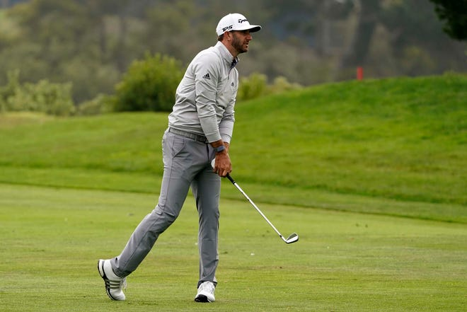 Dustin Johnson hits from the fairway on the 18th hole during the third round of the PGA Championship golf tournament at TPC Harding Park Saturday in San Francisco. (AP Photo/Charlie Riedel)