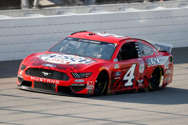 Kevin Harvick competes during a NASCAR Cup Series auto race at Michigan International Speedway in Brooklyn, Mich., Saturday, Aug. 8, 2020. (AP Photo/Paul Sancya)