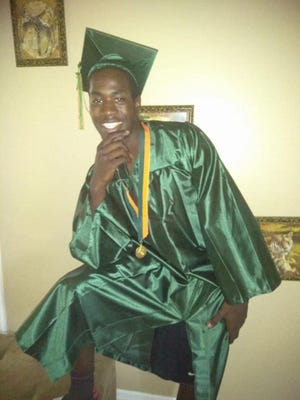 Johnny Jackson, 22, in his Dunbar High School graduation photo, was fatally shot July 15 at the Lani Kai Island Resort. Two lawsuits claiming wrongful death and injury to a third party were filed Sunday in Lee County Court against the resort.