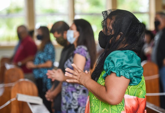 Parishioners commemorate the Chagui'an Massacre with a memorial Mass at Our Lady of Lourdes Catholic Church in Yigo in this Aug. 9 file photo. The Catholic Church willhold as many indoor Masses as possible, but some island churches aren't yet ready to hold indoor services.