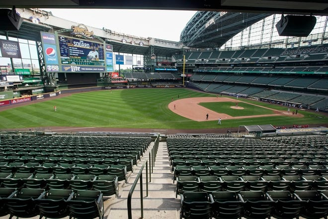 The seats at Miller Park are empty during the Brewers-Reds game on Sunday.