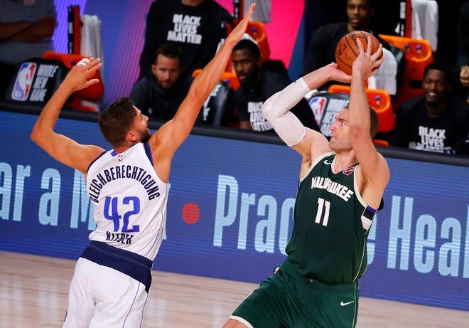 Bucks center Brook Lopez shoots against the Mavericks' Maxi Kleber on Saturday.