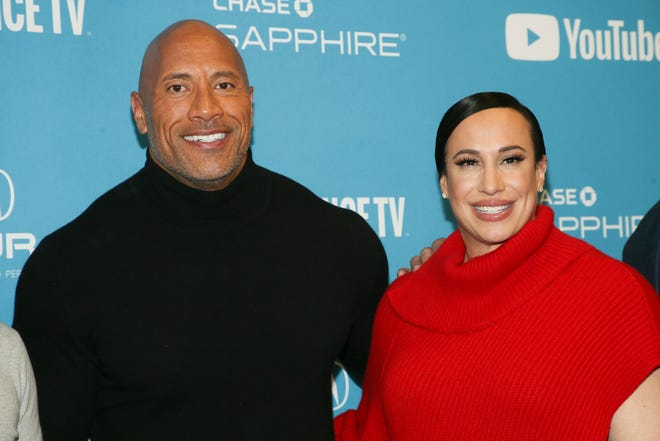 "Producer and cast member Dwayne Johnson, left, and producer Dany Garcia pose at the premiere of the film ""Fighting With My Family"" during the 2019 Sundance Film Festival, Monday, Jan. 28, 2019, in Park City, Utah.  Johnson and Garcia are part of a group that bought the XFL."