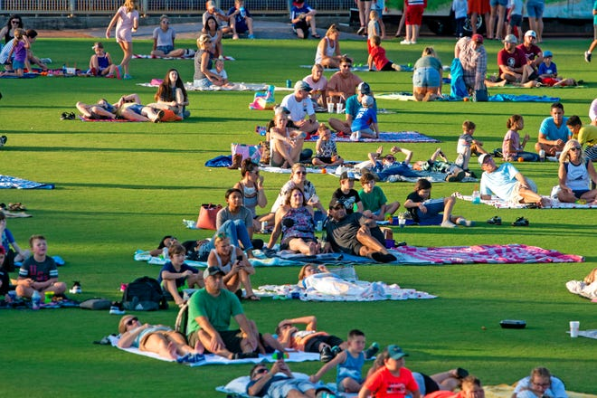 """The Pensacola Blue Wahoos host a family-friendly """"Summer Spectacular"""" at Blue Wahoos Stadium on Saturday, Aug. 8, 2020. The event featured a showing of the classic baseball film """"The Sandlot"""" on the videoboard and an extended post-movie fireworks show. The event was originally scheduled to take place on the Fourth of July but was postponed due to a surge in local COVID-19 cases and inclement weather."""
