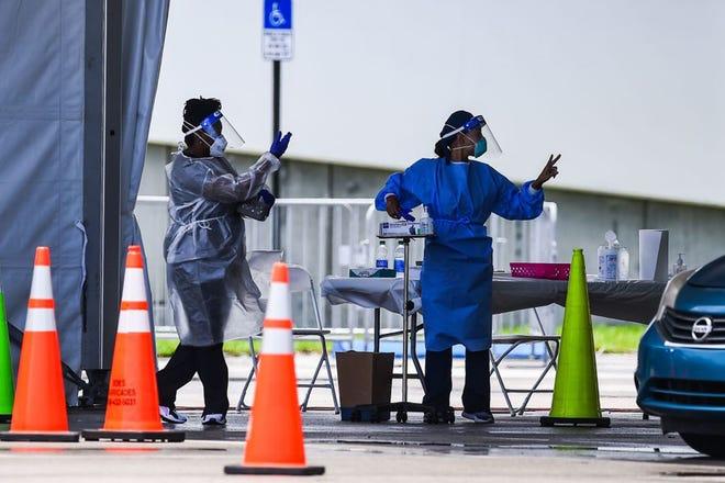 Medical staff prepare to administer a rapid antigen coronavirus test at Hard Rock Stadium in Miami Gardens near Miami, Florida on August 5, 2020. (Photo by CHANDAN KHANNA/AFP via Getty Images/TNS)