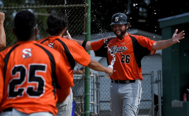 The Stoverstown Tigers celebrate as Austin Rickrode crosses home plate, scoring on a bases-loaded walk by Nick Spangler, Sunday, August 9, 2020.John A. Pavoncello photo