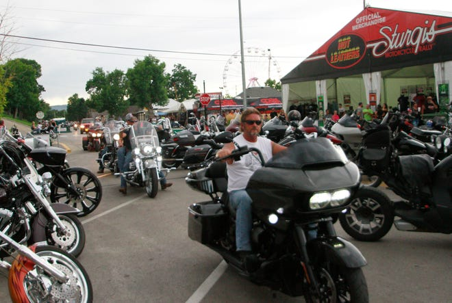 Bikers ride through downtown Sturgis, S.D., on Aug. 7, 2020. Organizers of the Sturgis Motorcycle Rally expected 250,000 people to visit the town of Sturgis during the 10-day rally.