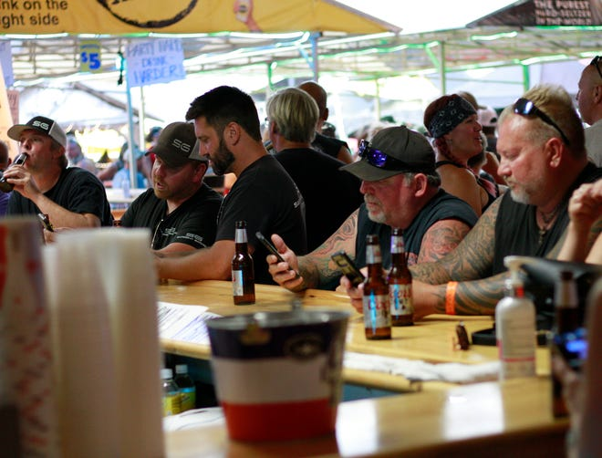 People crowded around bars in Sturgis, S.D., on Friday, Aug. 7, 2020 during the 80th anniversary of the Sturgis Motorcyle Rally.