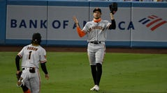 San Francisco Giants outfielder Hunter Pence reacts after losing a pop-up in the lights.