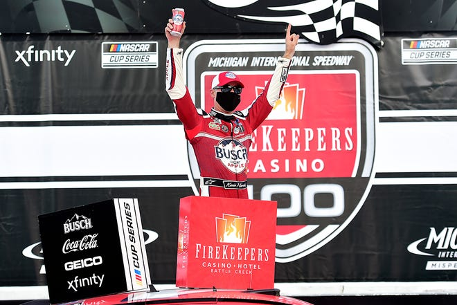 Kevin Harvick celebrates after winning the FireKeepers Casino 400 Saturday at Michigan at Michigan International Speedway.