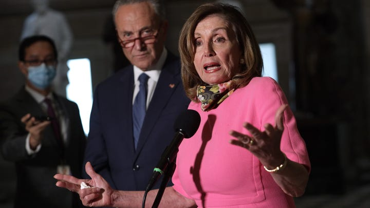House Speaker Nancy Pelosi, D-Claif., and Senate Minority Leader Charles Schumer, D-N.Y., speak to members of the press after a meeting with Treasury Secretary Steven Mnuchin and White House Chief of Staff Mark Meadows at the U.S. Capitol Aug. 7, 2020 in Washington.