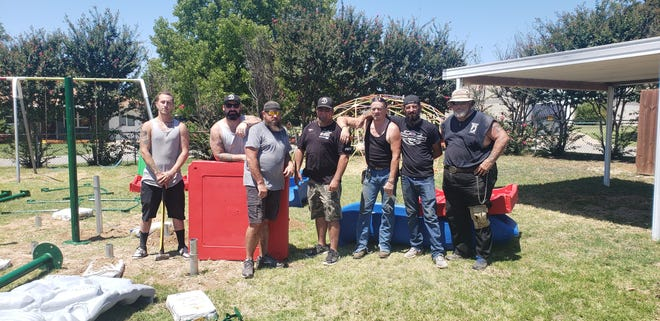 Members of the Forsaken Few Motorcycle club volunteered to install new sensory playground equipment at the TABI school in Ardmore on Sunday. The new equipment will be utilized by both the TABI school and the Boys and Girls Club of Ardmore.